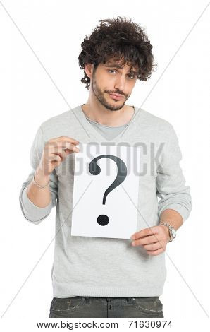 Confused Young Man Showing Question Mark Signboard Isolated On White Background