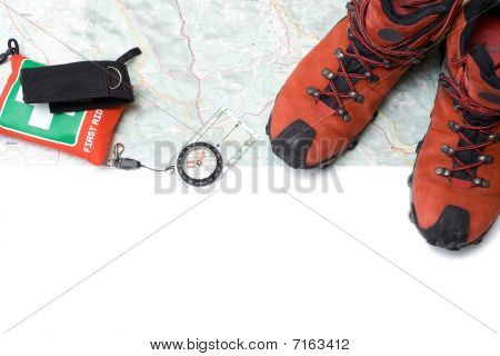 Hiking shoes equipment on map isolated clipping path