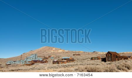 Old Western Ghost Town By Mountain Blue Sly