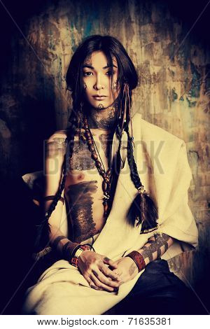 Art portrait of the American Indian. Ethnicity. Historical reconstruction.