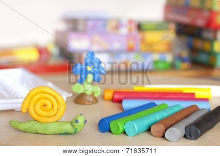 Plasticine on table with snail