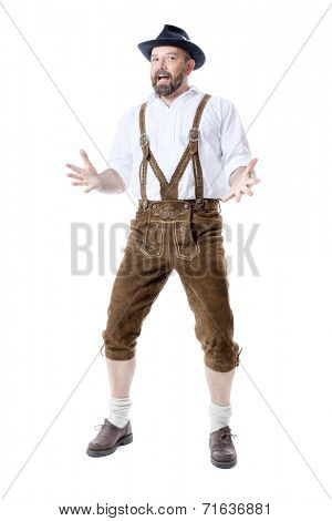 A traditional bavarian man isolated on a white background presenting something