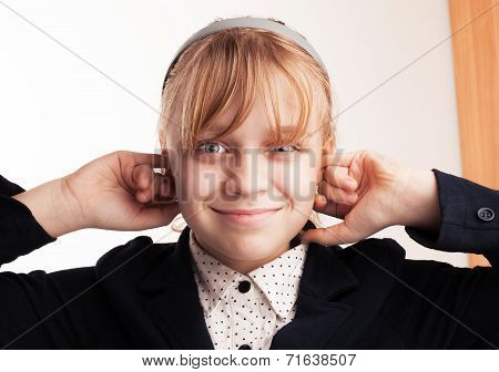 Blond Smiling Schoolgirl Plugs Fingers In His Ears
