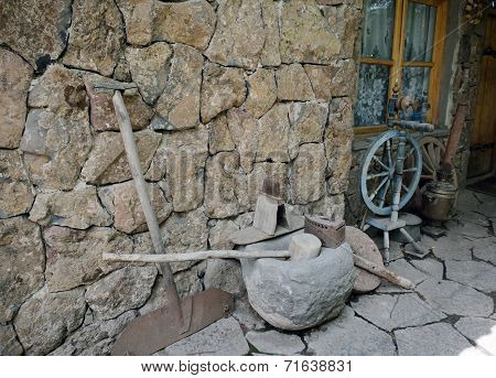Ancient Tools And Everyday Objects Next To The Wall