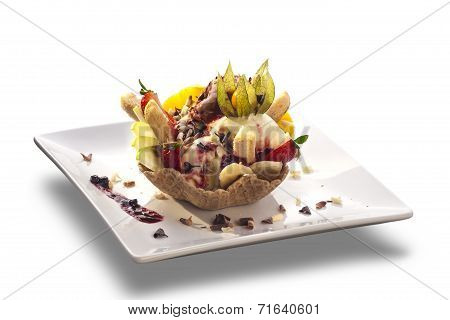 Delicious Ice Cream Sundae With Fresh Fruits In Wafer Bowl Decorated With Pieces Of Chocolate