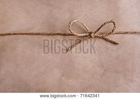 Paper texture with rope bow, close-up