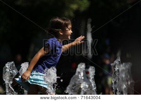 Happy child running in water
