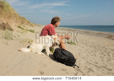 Man And Dog On Beach.