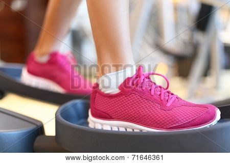 . Closeup of women feet during exercise training on moonwalker.