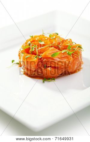 Slices of Salmon Served with Spicy Sauce