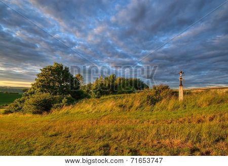 wayside cross in meadow