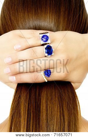 Closeup of a Model Wearing Tanzanite Designer Rings, Isolated on White