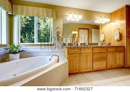 Bright Bathroom With Corner Bath Tub