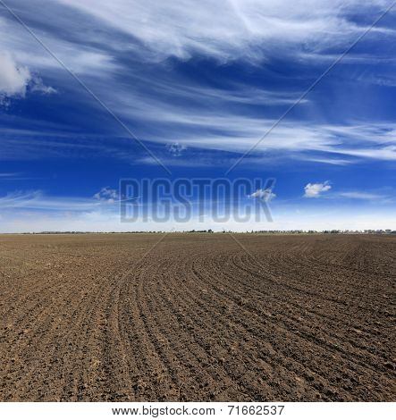 Plogged agricultural field under nice sky