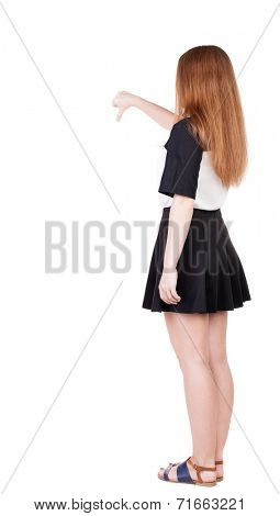 Back view of dissatisfied woman thumbs down. Rear view people collection. backside view of person. Isolated over white background. slender redhead in a dress shows hitchhiking