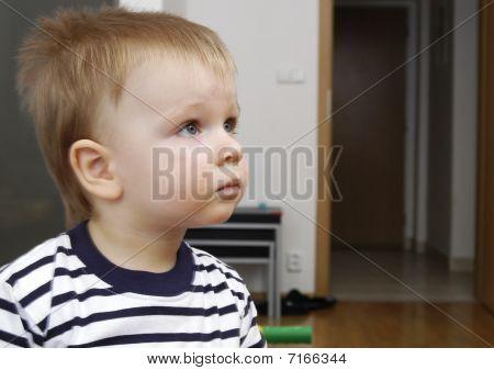 Toddler boy watches TV