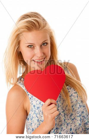 Beautiful Young Blonde Woman With Blue Eyes Holding Red Hart Banner For Valentines Day Isolated Over