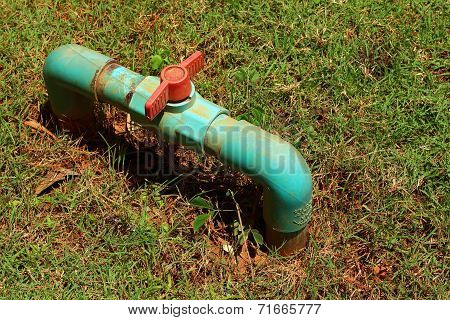 Water Valve On A Grass Background