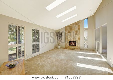 Beautitful Living Room With Vaulted Ceiling And Skylights. Empty House Interior