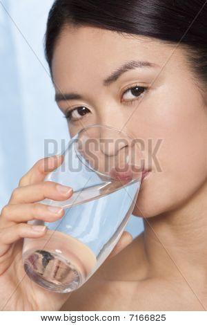 Beautiful Japanese Asian Woman Drinking Glass Of Water