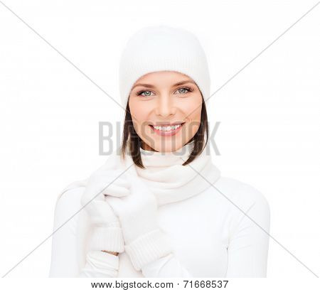 winter fashion andhappy people concept - woman in white hat, muffler and gloves