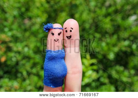 Face painted on fingers. Happy couple, the woman is pregnant.