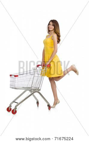 Woman with shopping trolley isolated on white