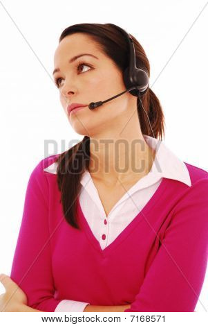 Young woman wearing headphones and talking into a mircophone