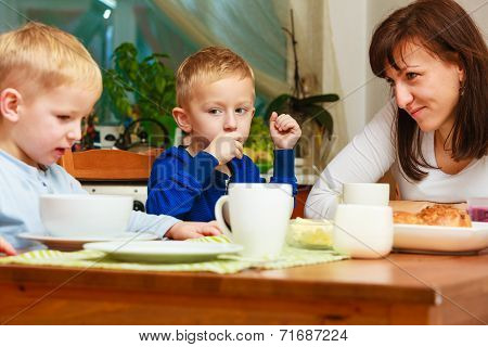 Happy Family. Mother And Sons Eating Breakfast.