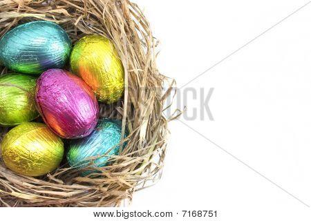 Easter Eggs In Nest On White