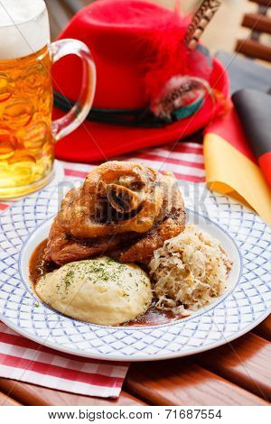 eisbein with braised cabbage, potato and beer