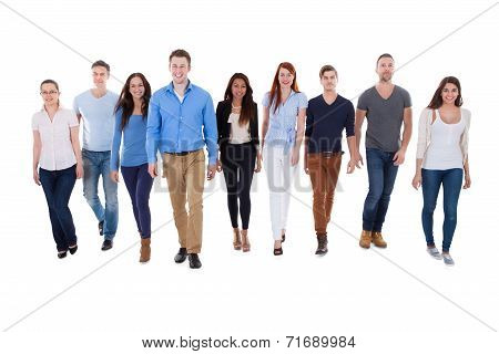 Diverse Group Of People Walking Towards Camera