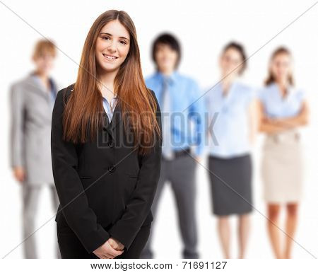 Portrait of a young smiling woman in front of a group of people