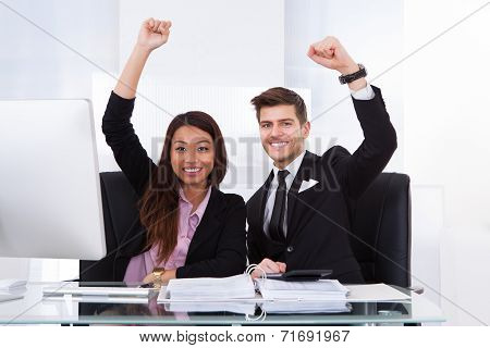 Successful Accountants With Hands Raised