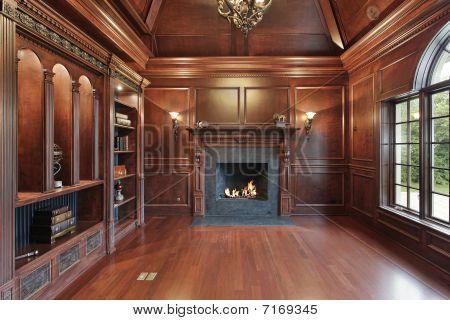 Elegante biblioteca con chimenea negro
