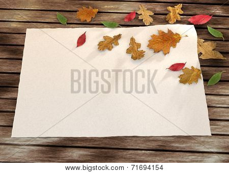 autumn greeting card on the wooden background with leaves.