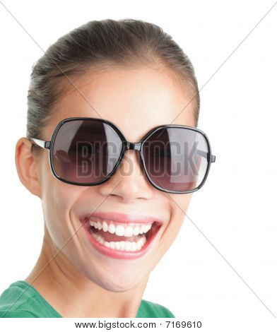 Woman With Big Sunglasses Smiling And Laughing