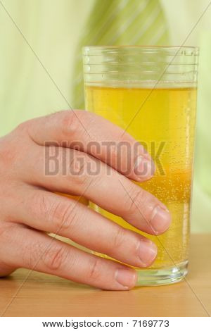 Hand On A Glass With Fresh Drink