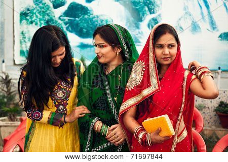 Happy Indian womens in colourful sarees