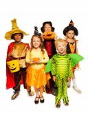 foto of bucket  - Five happy boys and girls standing together wearing Halloween costumes - JPG