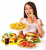 picture of high calorie foods  - Woman eating fast food - JPG