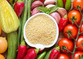 picture of millet  - Raw Organic millet in bowl and vegetables  - JPG