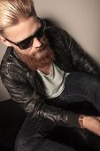 foto of down jacket  - Fashion man in leather jacket looking down - JPG