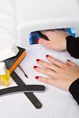 foto of uv-light  - an Hands with uv lamp for nails - JPG
