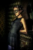 foto of masquerade mask  - Beautiful mysterious stranger girl in venetian mask - JPG