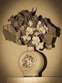 stock photo of yesteryear  - vintage yesteryear bowl of artificial flowers with vignetting - JPG