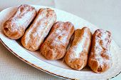 image of eclairs  - Appetizing eclairs with custard on a table  - JPG