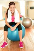 pic of pilates  - Fitness woman in gym resting on pilates ball  - JPG