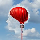 picture of descending  - Examining the brain medical concept or business aspiration metaphor as a man climbing or descending a ladder to an air balloon shaped as a human brain as a symbol for the freedom of intelligent thinking - JPG