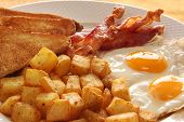 image of bacon  - Breakfast of eggs bacon toast and hash browns - JPG